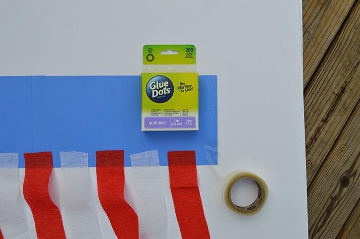 glue-dots-kids-craft-patriotic-windsock-adding-glue-lines.jpg