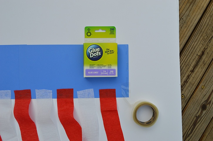 glue-dots-kids-craft-patriotic-windsock-adding-glue-lines.jpg