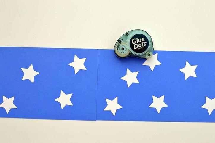 glue-dots-kids-craft-patriotic-windsock-adding-stars.jpg
