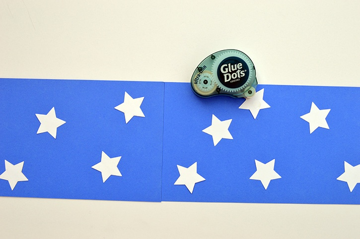 glue-dots-kids-craft-patriotic-windsock-adding-stars.jpg