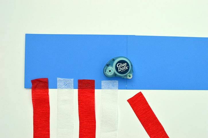 glue-dots-kids-craft-patriotic-windsock-adding-streamers.jpg