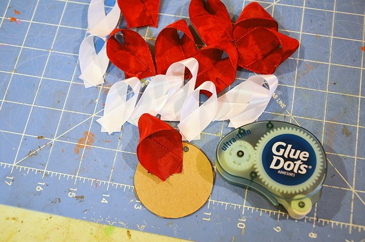 glue-dots-ribbon-ornament-adhering-ribbon-to-cardboard-circle.jpg