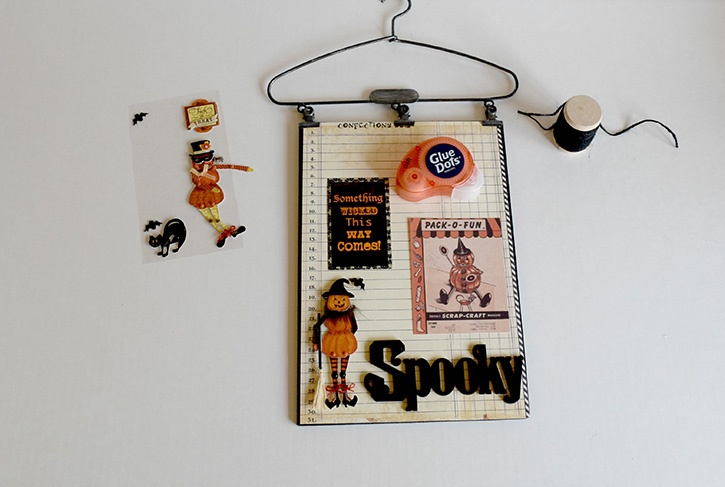 glue-dots-halloween-spooky-sign-pieces-arranged-on-board.jpg