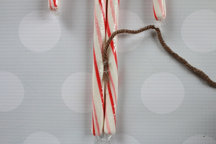 glue-dots-candy-cane-reindeer-wrapping-yarn-around-candy-canes.jpg
