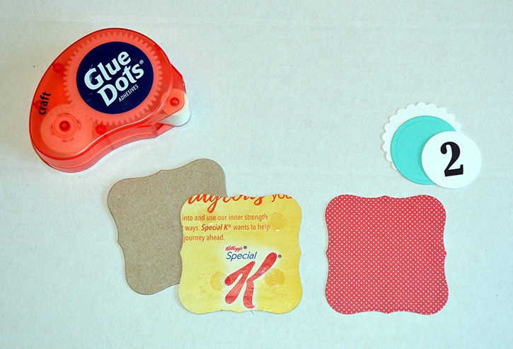 glue-dots-muffin-tin-advent-calendar-layering-cardboard-paper-pieces.jpg