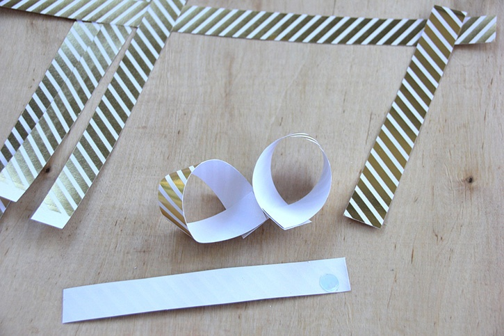 glue-dots-paper-gift-bow-cut-strips-glued-loops.jpg