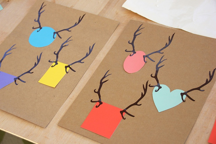 glue-dots-reindeer-shape-cards-paper-pieces-antlers-adhered-to-cards.jpg
