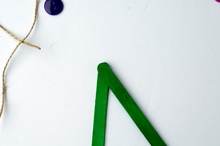 glue-dots-craft-stick-christmas-tree-button-ornament-craft-sticks-glued-together.jpg