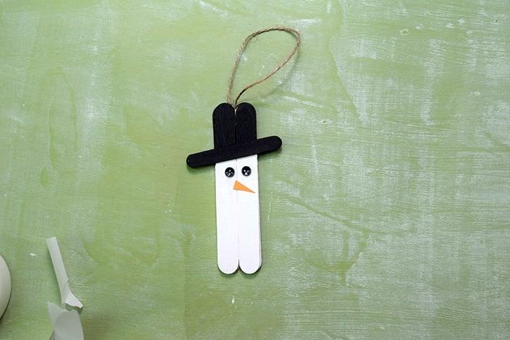 mini-snowman-ornament-adding-eyes-nose-micro-dots.jpg