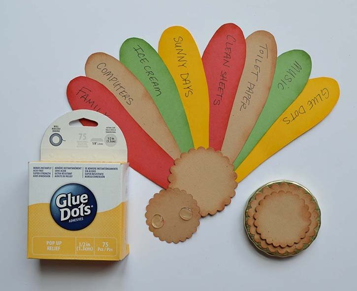 glue-dots-turkey-jar-thankful-notes-on-feathers.jpg