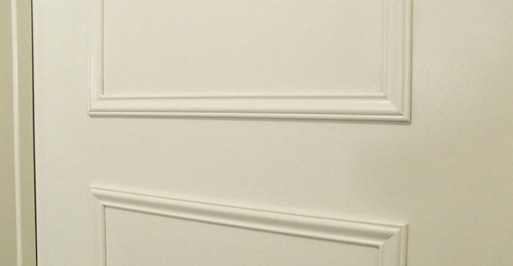 Decorative trim added to a plain door with Glue Dots HybriBond Repositionable Mounting Tape