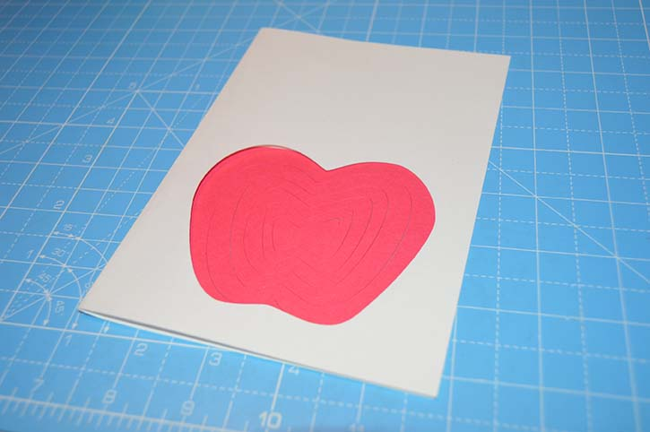 glue-dots-spiral-apple-card-placed-on-card.jpg